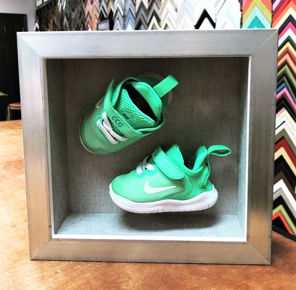 baby shoes in a shadowbox